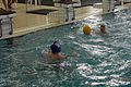 A U.S. Marine with 1st Reconnaissance Battalion holds a polo ball during a water polo tournament at Al Asad Air Base, Iraq, March 15, 2009 090315-M-KL291-045.jpg