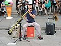 A free lancer music artist playing instrument at Milan Cathedral ,Italy.jpg