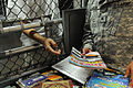 A soldier from the detainee library hands a periodical to a detainee in Camp Five DVIDS368267.jpg