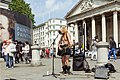 A street musician in Trafalgar Square.jpg