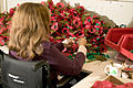 A volunteer constructs poppies at the Royal British Legion Poppy Factory, Richmond MOD 45148164.jpg