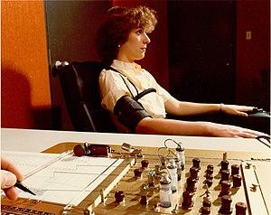 Polygraph - Demonstrating the administration of the polygraph, the polygrapher making notes on the readouts. 1970s