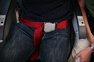 "Seat belt - A lap (""2-point"") belt in an airplane"