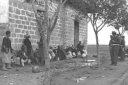 Arab civilians and Israeli soldiers in al-Faluja after the اسرائیلی دفاعی افواج entered the village, 1949