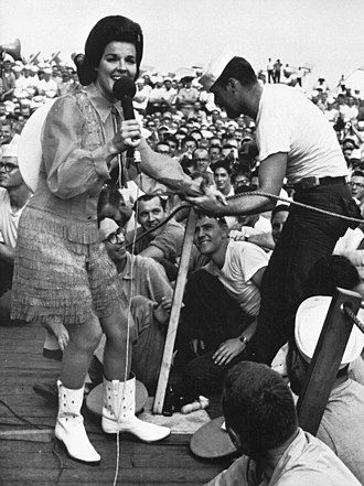 Anita Bryant - Anita Bryant with a sailor during a Bob Hope USO show on the USS Ticonderoga in 1965