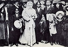 Photograph of Krishnamurti with his brother Nitya, Annie Besant, and others in London 1911