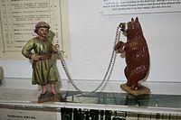Antique toy dancing bear (26478510832).jpg