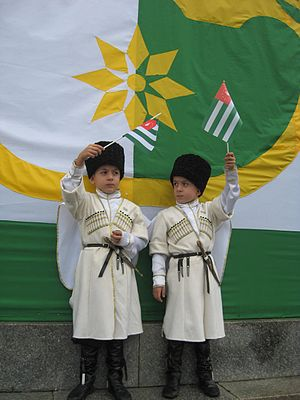 Flag of Abkhazia - Image: Apsua Childs waving Apsny Flag
