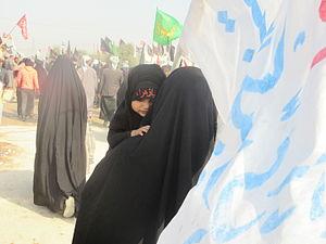 Arba'een Pilgrimage - A little girl participating 2015 Arbaeen pilgrimage with her mother