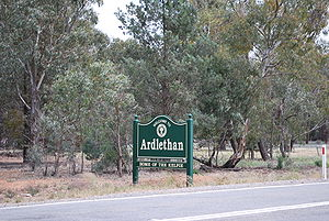 "Australian Kelpie - Sign at Ardlethan, New South Wales, claiming the town as ""The home of the Kelpie"""
