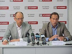 """Mykola Tomenko - Mykola Tomenko seated with Arseniy Yatsenyuk, then the leader of the All-Ukrainian Union """"Fatherland""""."""
