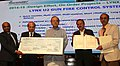 Arun Jaitley awarding the Bharat Electronic Limited, Bengaluru for 'On Initiative Projects' (2014-15) in manufacturing LYNX U2 Naval Gun Fire Control System for the Indian Navy.jpg