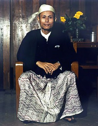 Burmese clothing - Aung San dons a gaung baung and taikpon (jacket).