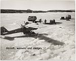 Auster aircraft fitted with skis, weasels and sledges on the fast ice near the Mawson Station in Antarctica (6433877755).jpg