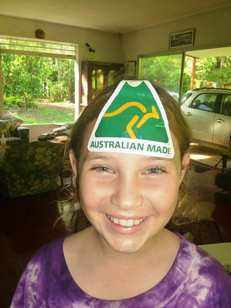 Australian Made logo - A girl with the 'Australian Made' sticker in Cooktown, Queensland
