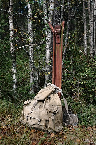 The Holocaust in Norway - Backpack used by Jewish refugees, placed at remnants of gate at a border crossing to Sweden