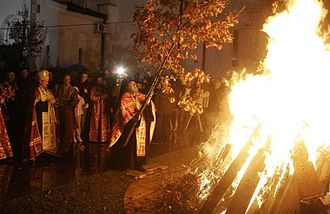 Badnjak (Serbian) - A Serbian Orthodox priest places the badnjak on a fire during a Christmas Eve celebration at the Cathedral of Saint Sava in Belgrade.