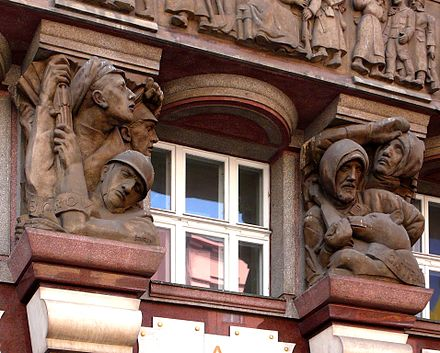 The facade of the Legiobanka main office in Prague is decorated with reliefs of war scenes. Bank of the Czechoslovak Legions, Prague.jpg