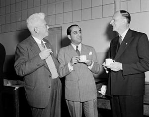 """Pro-nuclear movement - During a two-day symposium on """"Atomic Power in Australia"""" at the New South Wales University of Technology, Sydney, which began on 31 August 1954, Professors Marcus Oliphant (left), Homi Jehangir Bhabha (centre) and Philip Baxter, share a cup of tea"""