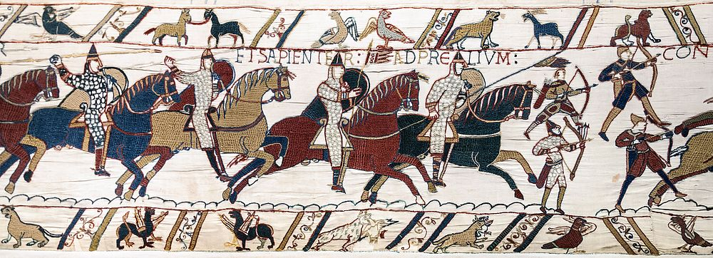 Norman archers depicted in the Bayeux Tapestry.  The top left archer was caught unprepared and has hastily thrown his belt quiver about his shoulders, as well as forgetting his helmet.