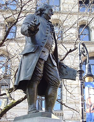 Pennsylvania Gazette - Statue of Benjamin Franklin holding a copy of The Pennsylvania Gazette