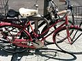 Bike locked to post and ring on sidewalk, King Street, Toronto.jpg