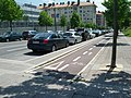 Bikeway protected by parked cars and narrow median (18824934181).jpg