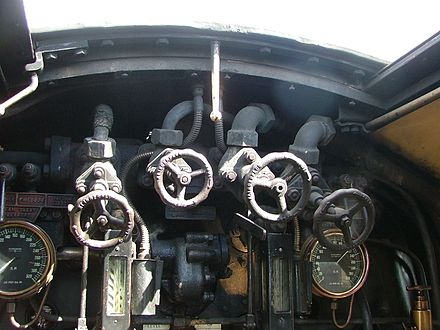Pressure gauges on Blackmore Vale. The right-hand one shows boiler pressure, the one on the left steam chest pressure. Blackmore Vale boiler backplate.jpg