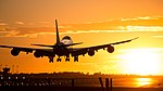 Boeing 747 landing at Barcelona in a golden sunset.jpg
