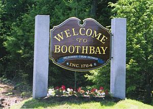 "Boothbay, Maine - Welcome to Boothbay sign featuring the motto Pelegrinis cibum dedimus, Latin for ""We fed the Pilgrims"""