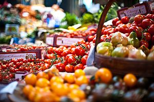 Photograph of tomatoes on a vegetable stall at...