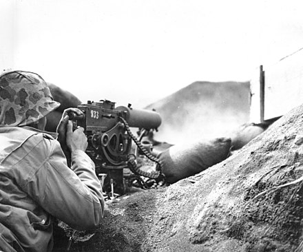 A U.S. Marine firing his Browning M1917 machine gun at the Japanese Browning M1917 Marine Iwo Jima fixed.jpg