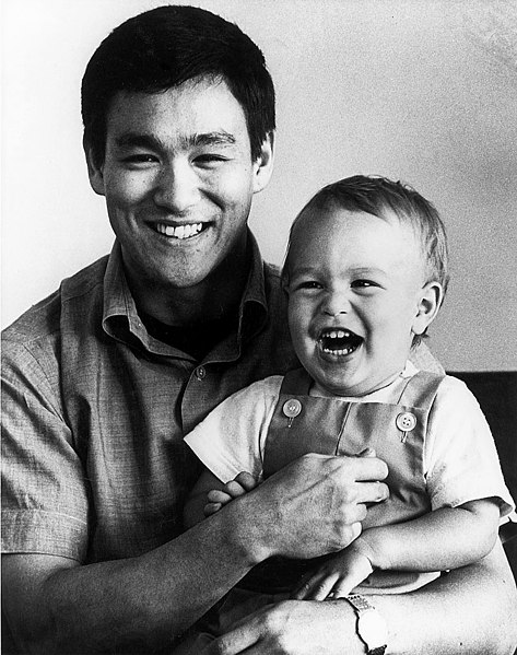 Publicity photo of Bruce Lee with son Brandon. Per source, the photo was accompanied by an original color press kit folder for Enter the Dragon.""