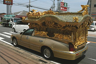Hearse - A Buddhist-style Japanese hearse built from a (1998–2011) Lincoln Town Car with standard wheelbase