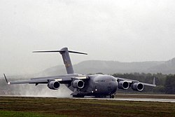 A USAF C-17 Globemaster returns to base from a humanitarian drop