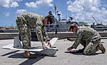 CRS 2 sailors assemble an RQ-20B Puma during visit to U.S. Naval Base Guam by Palau Vice President and his delegation.jpg