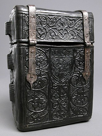 Boiled leather - Case for a book, with fittings for a carrying-cord, 15th century. The coat of arms (on the other side) suggests it was made for a bishop.