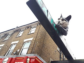 Catford - The Catford Cat - a giant statue in Catford town centre, depicting a giant cat clawing at the Catford Centre sign.