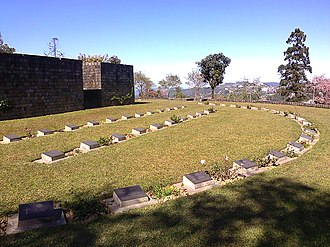 Kohima War Cemetery - War Cemetery with Kohima City in background