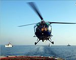 Chetak helicopter of the Indian Navy landing on Helodeck at sea.jpg