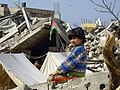 Child in the ruins after the 2009 Gaza War.jpg