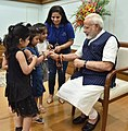 Children tying 'Rakhi' on the Prime Minister, Shri Narendra Modi's wrist, on the occasion of 'Raksha Bandhan', in New Delhi on August 07, 2017 (2).jpg