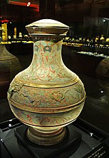 painted pottery pot with raised reliefs of dragons and