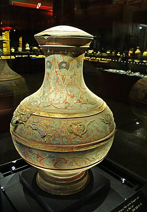 Government of the Han dynasty - A Western-Han painted ceramic jar with raised reliefs of dragons, phoenixes, and taotie designs