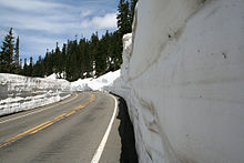 SR 410, east of Tipsoo Lake, approaches Chinook Pass, which serves as the border between Pierce and Yakima counties and between the Mount Rainier National Park and Wenatchee National Forest, in June when snow levels are still high and snow plows still are in use.