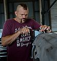 "Chuck ""The Iceman"" Liddell, a retired American mixed martial artist, tightens a bolt.jpg"