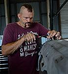 """Chuck """"The Iceman"""" Liddell, a retired American mixed martial artist, tightens a bolt.jpg"""
