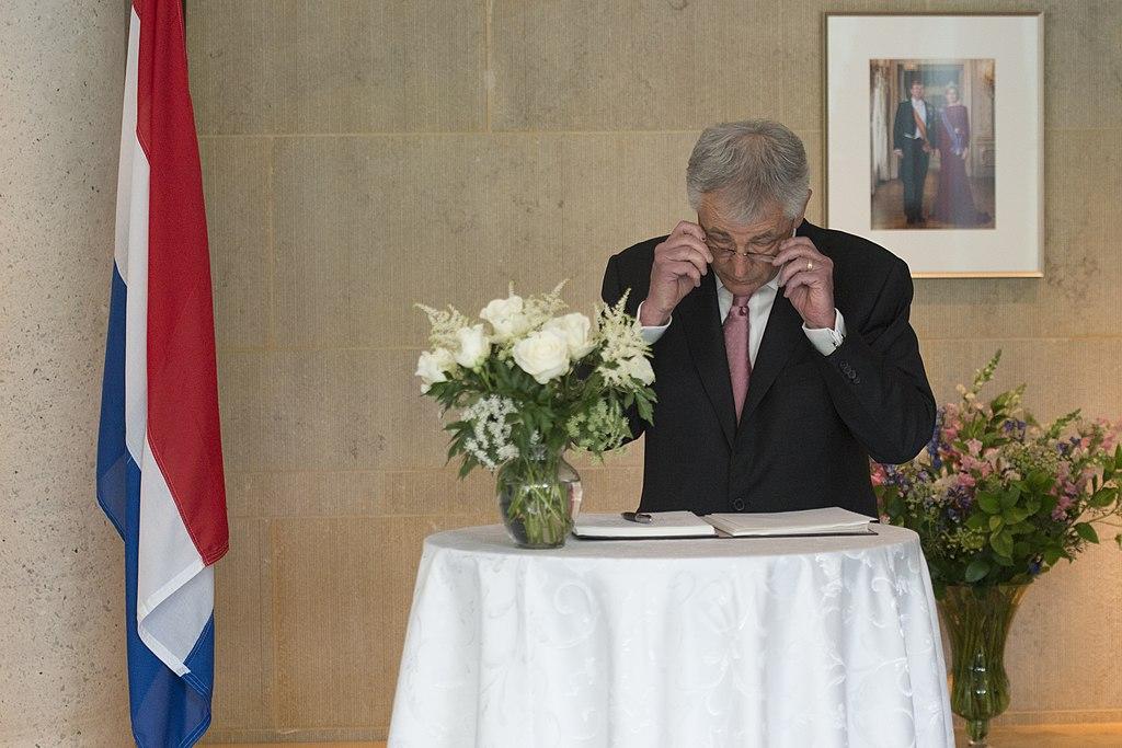 English secretary of defense chuck hagel signs a condolence book for