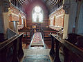 Church of the Holy Trinity - nave from chancel without flash - East Grimstead, Wiltshire, England.jpg