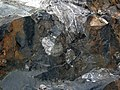 Clast-rich impact pseudotachylite (Sudbury Breccia, Paleoproterozoic, 1.85 Ga; Windy Lake Northwest roadcut, Sudbury Impact Structure, Ontario, Canada) 96 (33881815418).jpg